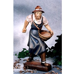 Woodcarving farmer sowing